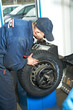 machanic repairman at tyre balancing adjustment