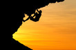 silhouette of climber in sunset