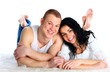 Beautiful loving couple lying on the floor - isolated