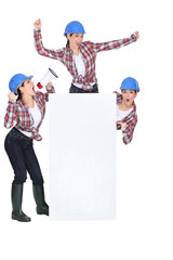 Construction woman holding blank poster