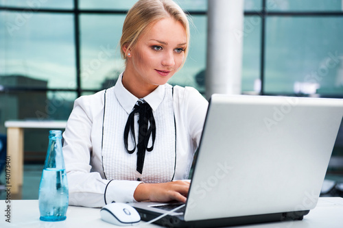 Portrait of a young businesswoman on the computer