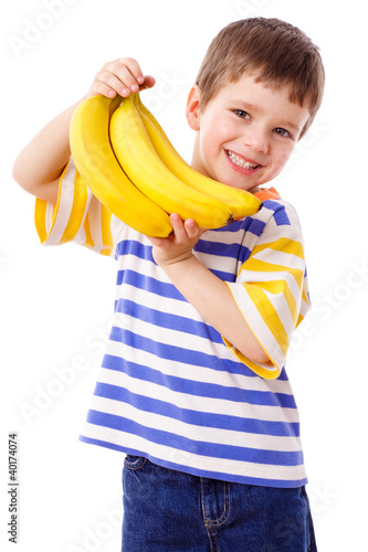 Happy boy holds a bunch of bananas