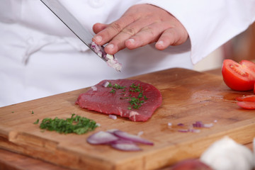 cook preparing steak