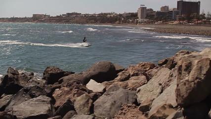 Kitesurfer on the sea, slow motion, steadicam shot