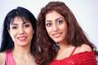 Two beautiful Latina women colorful look