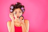Makeup mascara woman with hair rollers - 40178815