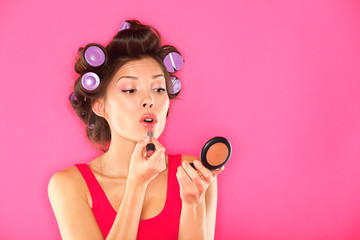 Makeup woman putting lipstick