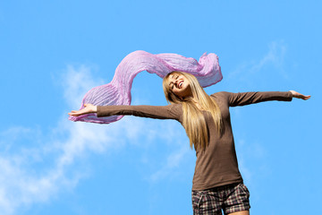Girl with arms open outdoors.