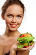 Girl with fruit burger