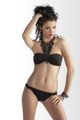 brunette girl posing in fashion bikini