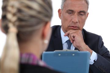 Businessman interviewing a woman