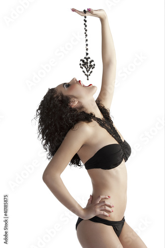 brunette girl eating jewellery