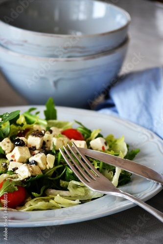 Greek salad on a blue plate