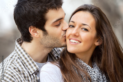 Close up kiss on girls cheek.