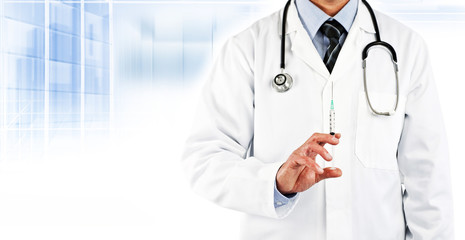 doctor in white coat holding needle