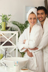 young couple together in the bathroom
