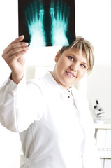 Female medic looking at x-rays