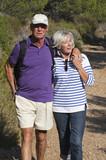 dynamic seniors enjoying hiking together poster
