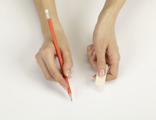 Hands with a pencil