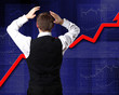 Young businessman against financial graphs
