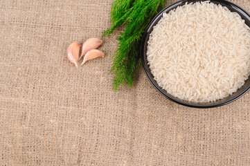 Rice with dill on the canvas