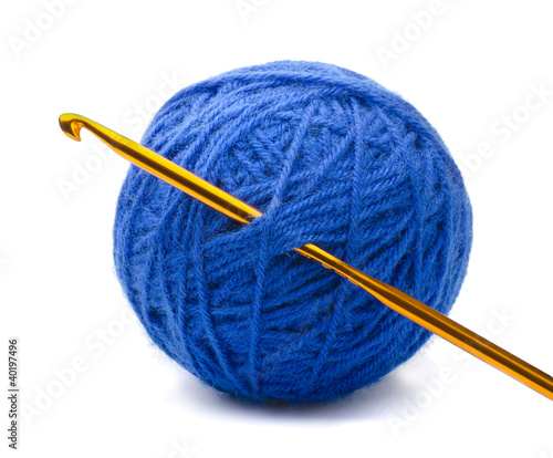 Ball of blue yarn and crochet hook