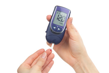 Diabetic patient measuring glucose level blood