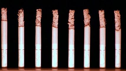 горящие сигареты