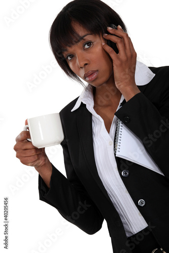 businesswoman on the phone having cup of coffee