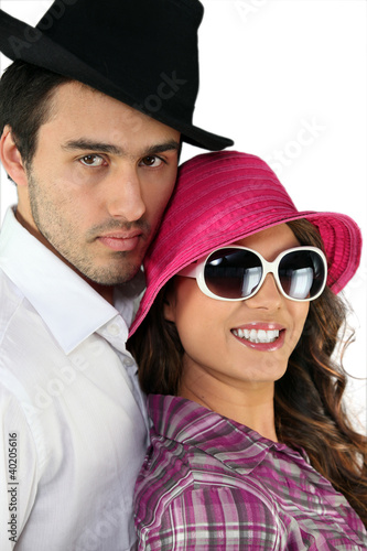 Couple wearing funny hats