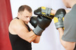 boxer man at boxing training with punch mitts