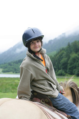 Little boy riding horse