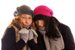 Two young women in winter clothes