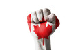 Fist painted in colors of canada flag
