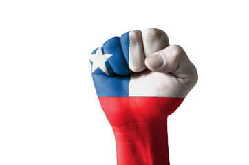 Fist painted in colors of chile flag