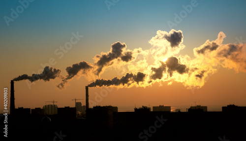 Exhaust smoke / Air pollution / Sunrise / Silhuette
