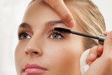 separating and curling lashes with mascara brush poster