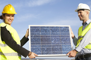 Engineers with solar panel