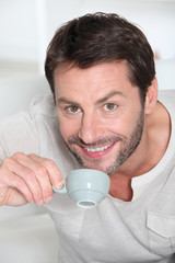 Man drinking a cup of coffee