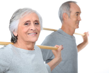 portrait of an old couple doing exercise