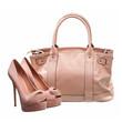 Beautiful platform shoes and handbag over white