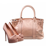 Beautiful platform shoes and handbag over white