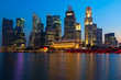 Singapore skyline and river in evening