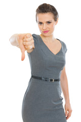 Modern business woman showing thumbs down