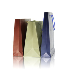 Colorful shopping bags on reflect floor and white background