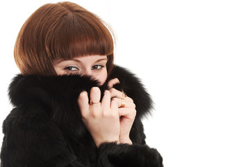 The girl in a black fur coat