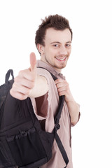 smiling young man with backpack and thumb up