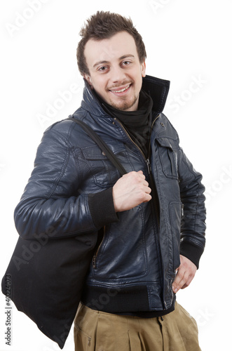smiling young guy in black jacket, white background