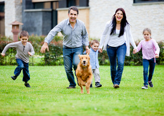 Family running with dog