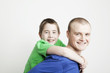 Portrait of beautiful smiling family: father and son